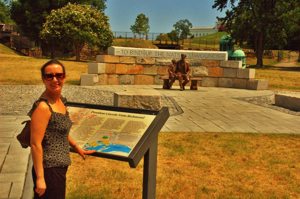 Amanda McWane in front of the Tredegar Iron Works Abraham Lincoln Memorial
